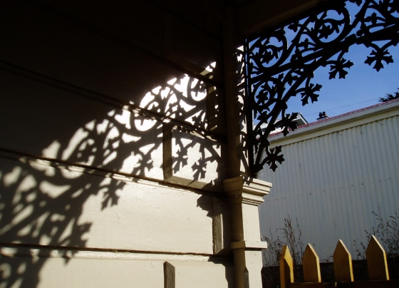 iron-work shadows on the house