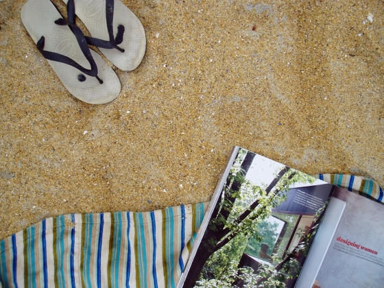 Picnic blanket, golden sand, and a good magazine